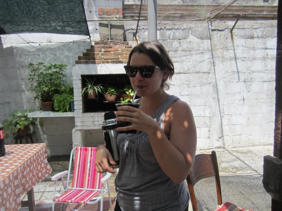 My wife assimilating into the ubiquitous culture of bitter yerba mate at my aunt's house in the Prado neighborhood of Montevideo, where my mother was born and where all my family there now lives.