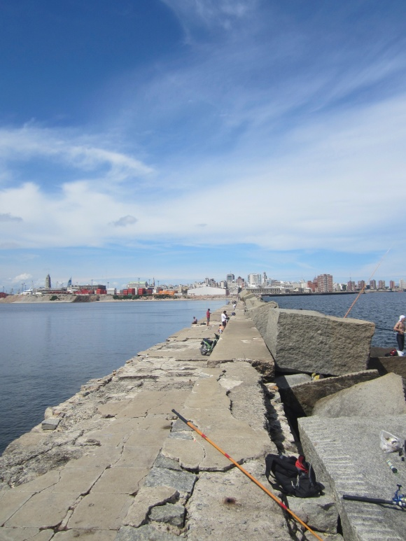 Where the street of Sarandi ends as a breakwater pier far out into the Rio de La Plata.