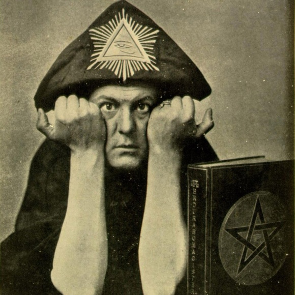 [Aleister Crowley wearing the head-dress of Horus making the sign of Pan, circa 1910]