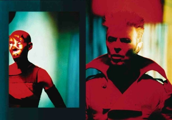 "[the incredibly skilled bassist Gail Ann Dorsey & Bowie in the 1997 video for ""Dead Man Walking"" directed by the always fascinating artist Floria Sigismondi. The song comes from Bowie's 1997 record of intricate glitch and textured, percussive loops, Earthling , which really deserves another listen by those who haven't in a while"