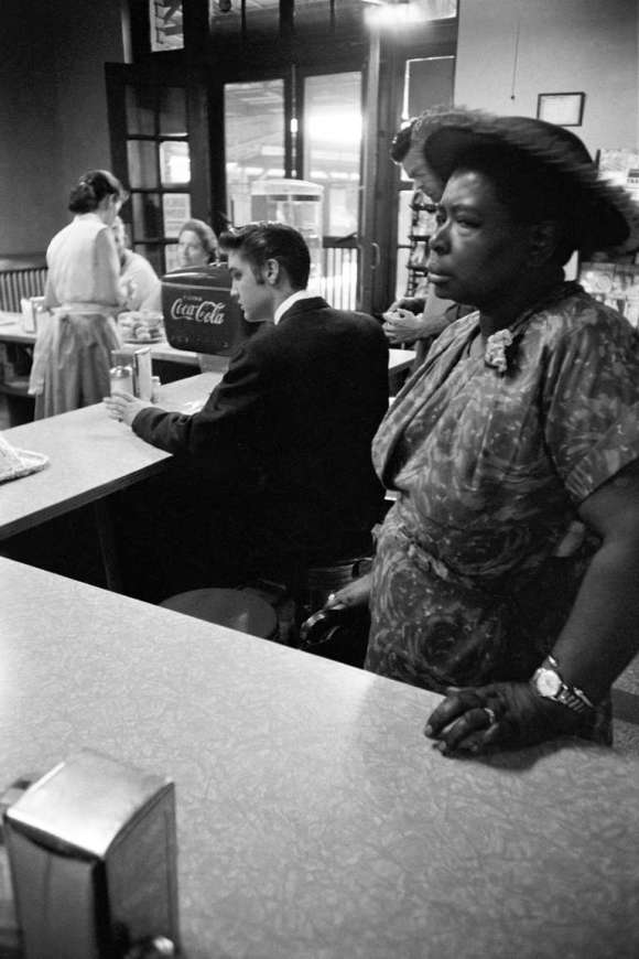 [Photo by Al Wertheimer, Segregated Lunch Counter: Elvis Presley waits for his bacon and eggs at the railroad station lunch counter while a black woman waits for her sandwich, Chatanooga, Tennessee, 1956]