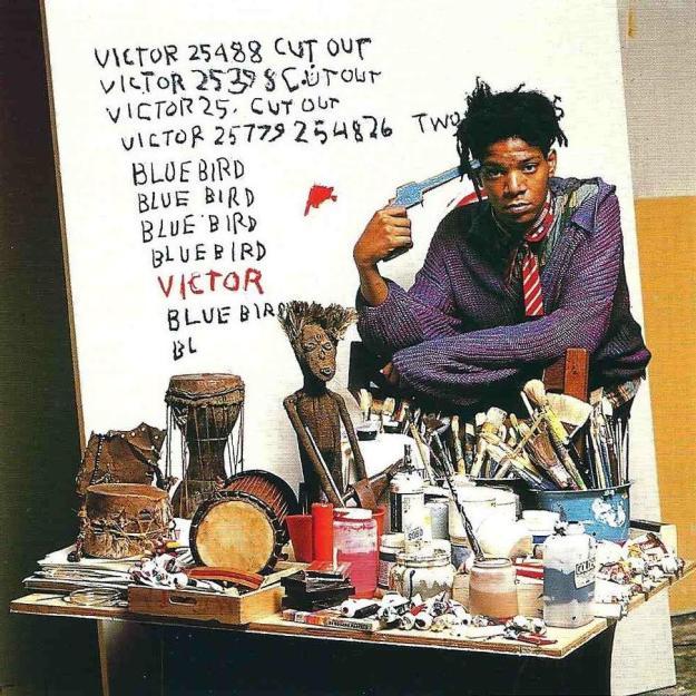 [Basquiat in his NYC studio, 1988.]