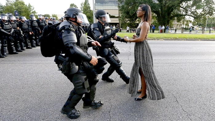 [Ieshia Evans protesting the shooting death of Alton Sterling is detained by law enforcement near the headquarters of the Baton Rouge Police Department in Baton Rouge, LA, on July 9, 2016.]