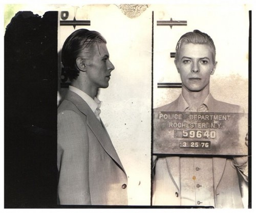 David Bowie's mugshot, dated March 25, 1976 after his arrest for marijuana along with James Osterberg, Jr. (a.k.a. Iggy Pop) by the Rochester, N.Y. Police Department]