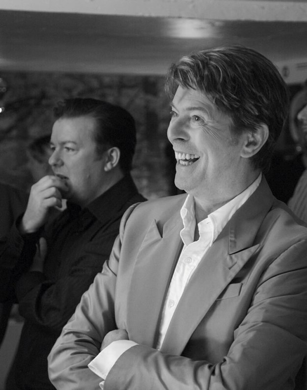 "Gervais & Bowie, June 2006, on the set for a hilarious episode of the series Extras where Bowie serenades Gervais with an impromptu tune describing him as ""chubby little loser""]"