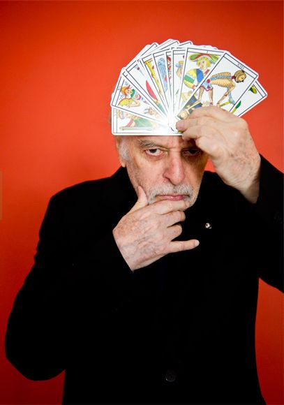 [Alejandro Jodorowsky , now 87 years-old, pictured with the Tarot de Marseille deck he helped design. photo by Evan Sung ]